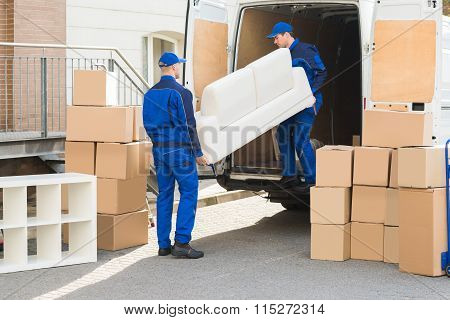 Movers Unloading Sofa From Truck