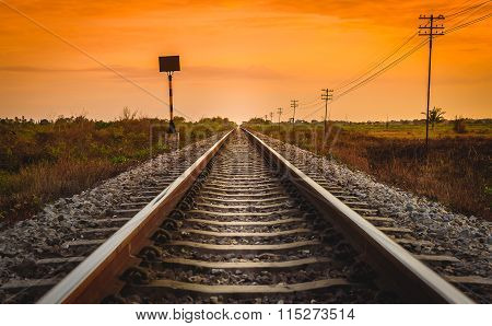 Railway Track In A Rural Scene At Sunrise Time.