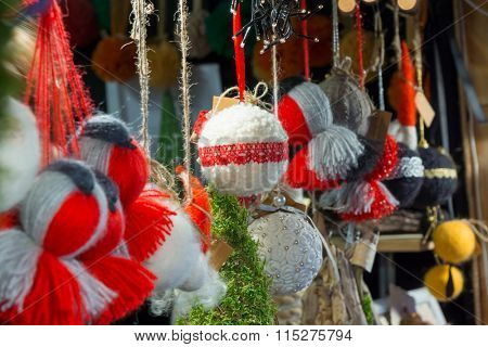 Handmade souvenirs at Christmas Fair in old town at evening in Vilnius, Lithuania