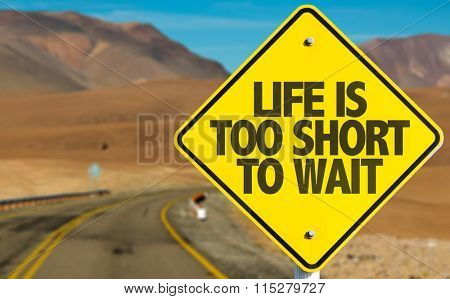 Life Is Too Short To Wait sign on desert road