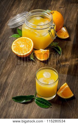 Freshly Squeezed Orange Juice With Slices Of Oranges.