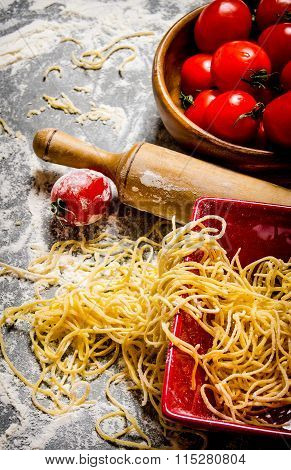 Noodles With Tomatoes And A Rolling Pin.