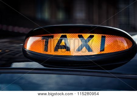 Typical black taxi cab in central London