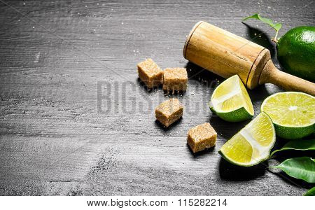 Lime Background.fresh Limes With Leaves, Sugar And Pestle .