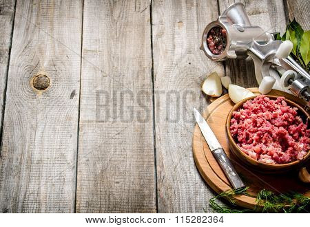 Preparated Minced Meat In A Bowl , Grinder And Spices With Herbs.