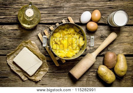 Ingredients For Mashed Potatoes - Eggs, Milk, Butter And Potatoes On Wooden Background.