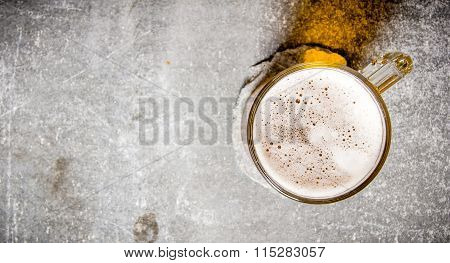 Beer In A Glass On Old Stone Surface.