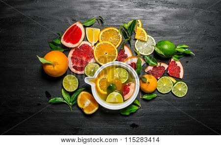 The Juice Of Citruses - Grapefruit, Orange, Tangerine, Lemon, Lime In A Cup.