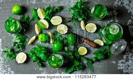Large Table With Ingredients For Making Mojitos - Lime, Mint Leaves, Rum, Sugar And Citrus Knife. Th