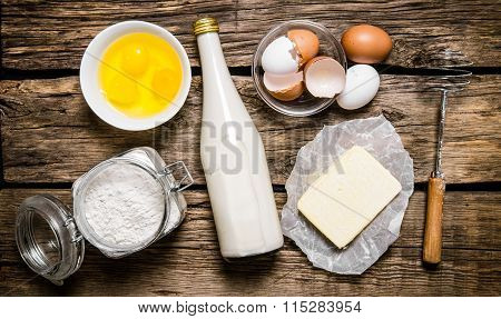 Preparation Of The Dough. Ingredients For The Dough - Milk, Eggs, Butter, Flour And Whisk.