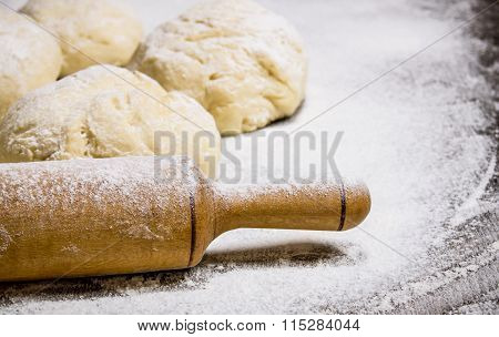 Preparation Of The Dough. The Prepared Dough With Flour And With A Rolling Pin.
