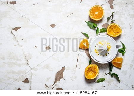 Juicer With Fresh Oranges. The Fresh Orange Juice.