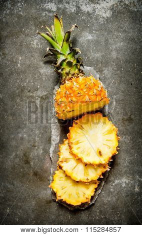 Fresh Sliced Pineapple On A Stone Stand.