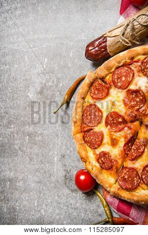 Pepperoni Pizza With Salami And Tomatoes. On Stone Table.