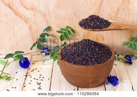 Rice Berry Rice With Wooden Bowl And Spoon On Wooden Table(rice Berry Is Crossbreed Between Two Bree