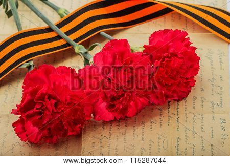 Carnations And St. George Ribbon