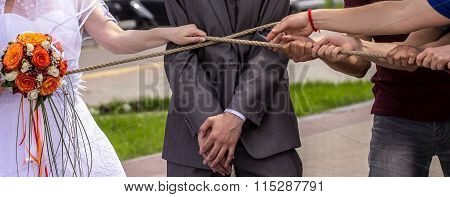 Hands Pulling Rope