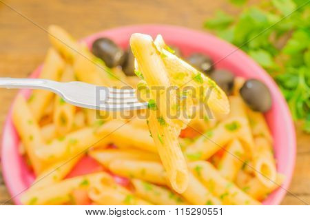 Ray Of Sunshine On Penne Pasta On A Fork