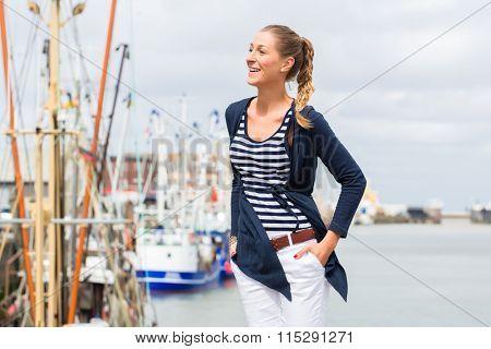 Woman enjoying vacation at German north sea ship pier