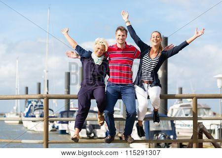 Friends enjoying vacation at German north sea ship pier
