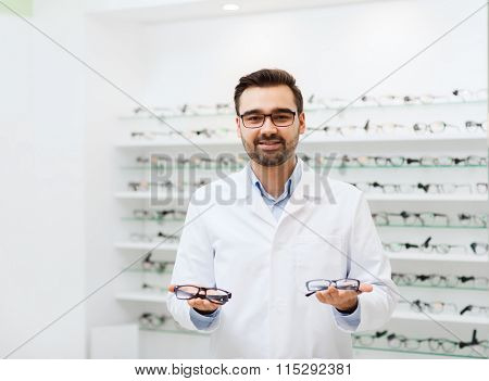 man optician with glasses in coat at optics store