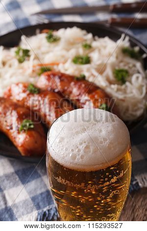 Beer On A Background Of Snack Sausages And Sauerkraut. Vertical
