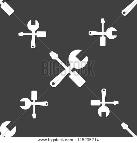 Wrench And Screwdriver Icon Sign. Seamless Pattern On A Gray Background.