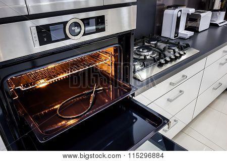Modern hi-tek kitchen, oven with door open