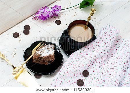 Piece Of Chocolate Cake And A Cup Of Coffee With Milk