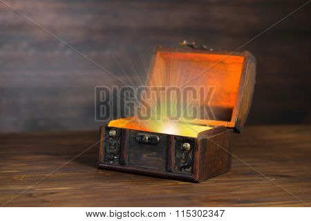 Beautiful Background Of Vintage Chest With Light Miracle On Wooden Plank And Place For Your Text, Cl