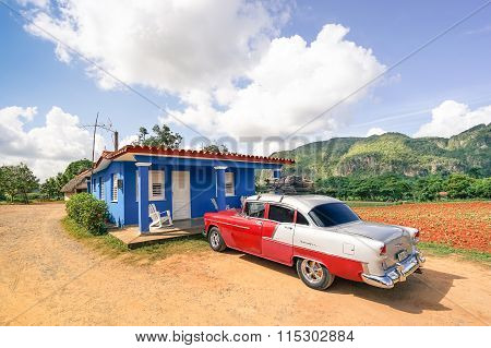Vintage Car Chevrolet Bel Air Parked At Farmer Bungalow In Val Vinales Cuba