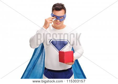 Sad superhero holding a box of wipes and crying isolated on white background
