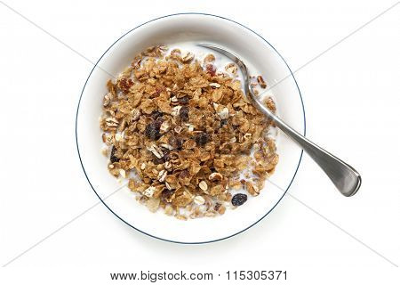Bowl of cereal with spoon, isolated on white.  Overhead view.