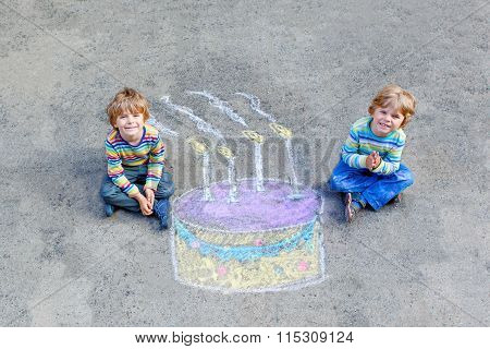 Two kid boys having fun with colorful birthday cake drawing with