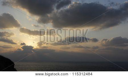 Sun Behind Cloud On Seashore With Sunset Sky