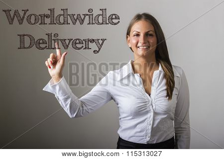 Worldwide Delivery - Beautiful Girl Touching Text On Transparent Surface