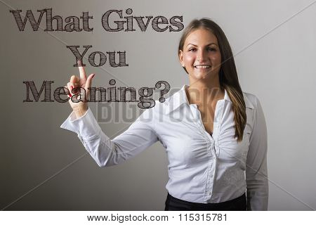 What Gives You Meaning? - Beautiful Girl Touching Text On Transparent Surface