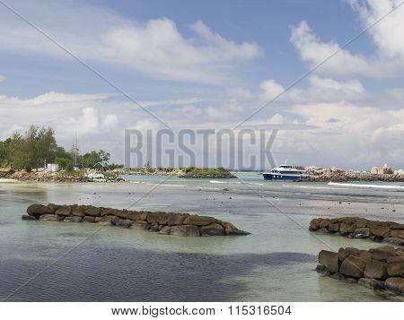Ferry Arrives On La Digue