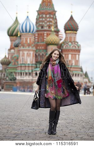 Portrait in full growth, Russian beautiful woman in a mink coat on the Red Square in Moscow