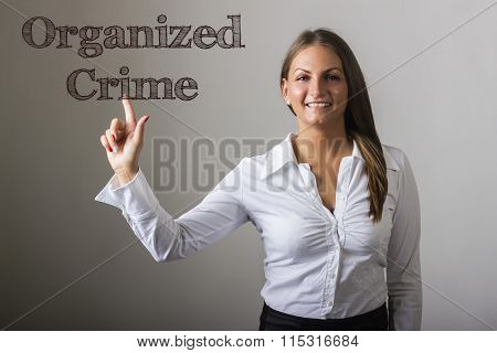 Organized Crime - Beautiful Girl Touching Text On Transparent Surface