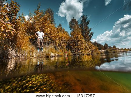 Young man fishing on a lake with underwater view of the bottom