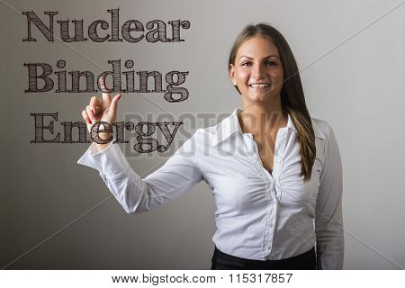 Nuclear Binding Energy - Beautiful Girl Touching Text On Transparent Surface