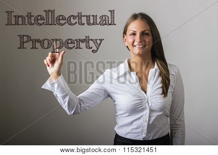 Intellectual Property - Beautiful Girl Touching Text On Transparent Surface