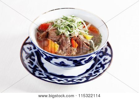 meat stew with vegetables peppers tomatoes Uzbek dish bowl  plate isolated white background