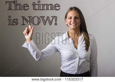 The Time Is Now! - Beautiful Girl Touching Text On Transparent Surface
