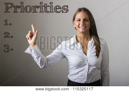 Priorities 1. 2. 3.  - Beautiful Girl Touching Text On Transparent Surface