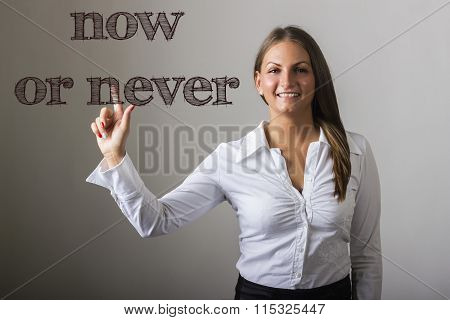 Now Or Never  - Beautiful Girl Touching Text On Transparent Surface