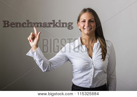 Benchmarking - Beautiful Girl Touching Text On Transparent Surface