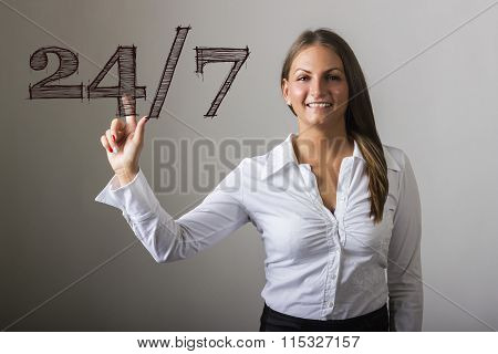 24/7 - Beautiful Girl Touching Text On Transparent Surface