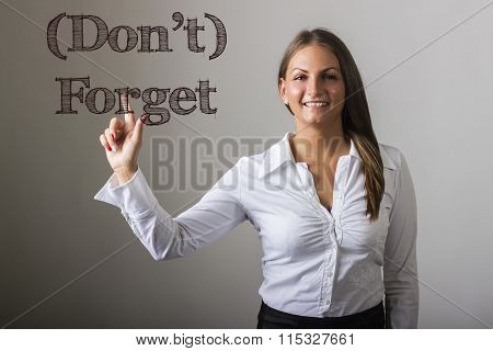 Don't Forget- Beautiful Girl Touching Text On Transparent Surface